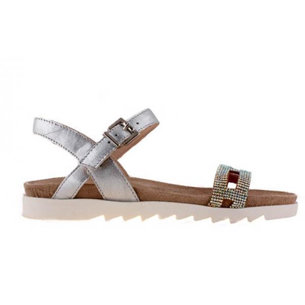 Sandalia en piel labrada color plata con plataforma blanca.